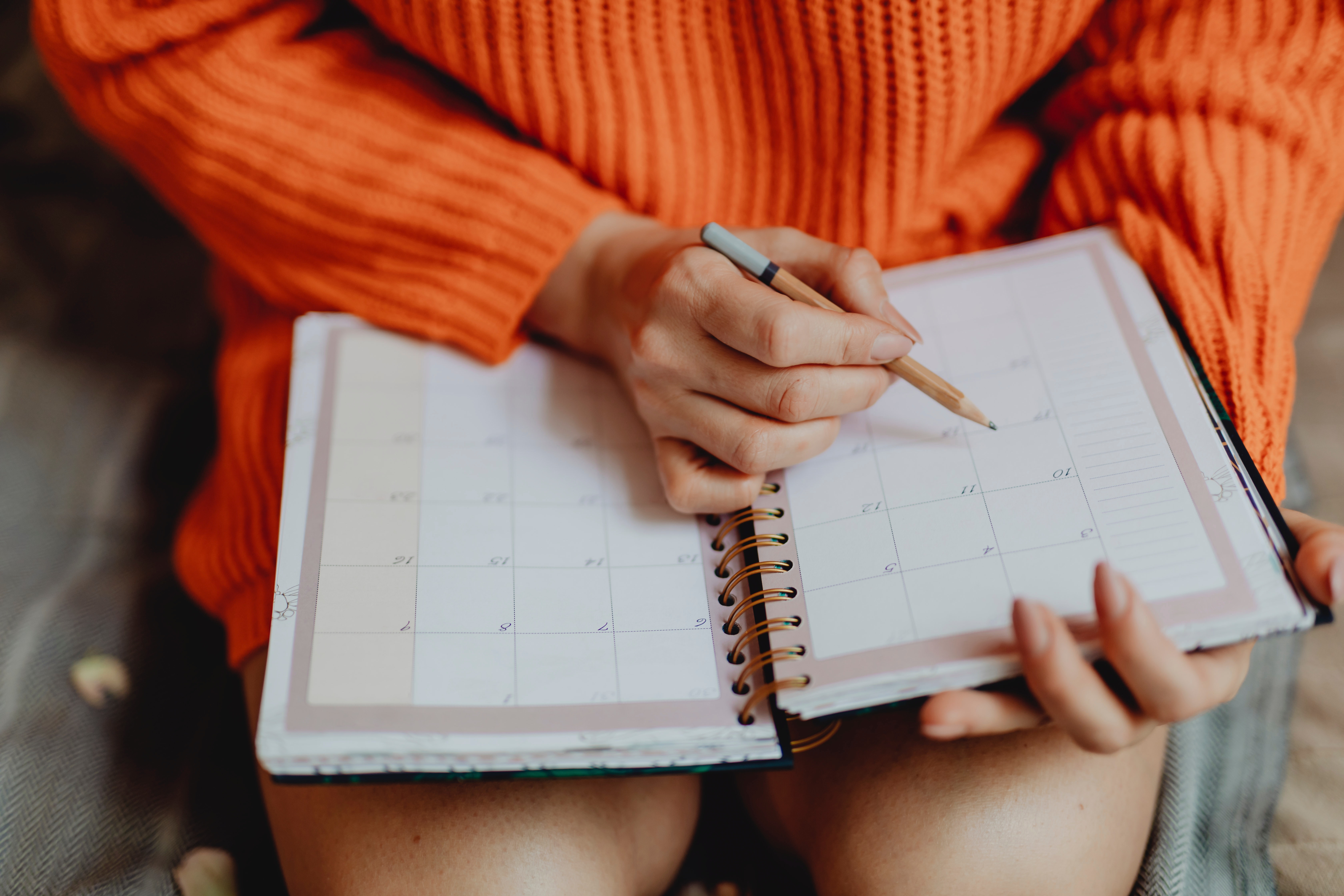 A woman writes down her study schedule so she can find a tutor with the same availability as hers