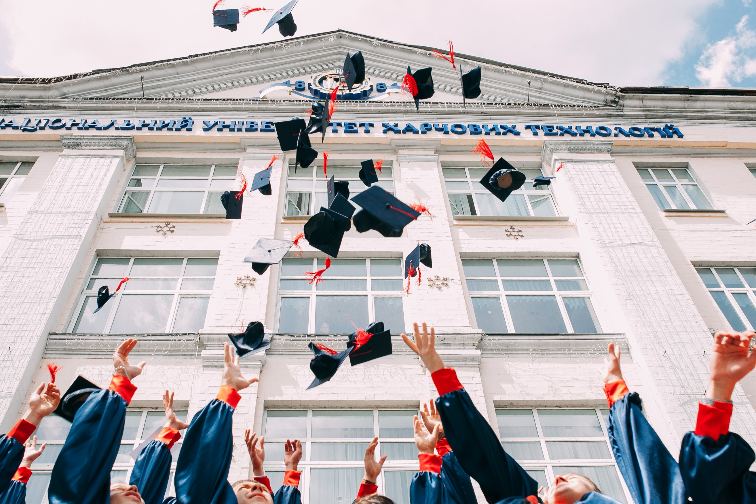 Students throw their graduation caps up in the air to celebrate their achievements